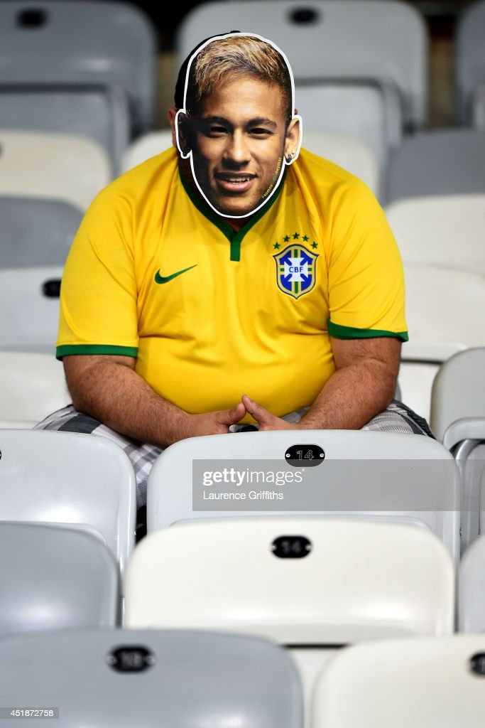 A Brazil fan wearing a Neymar mask looks on after a 7-1 defeat to Germany during the 2014 FIFA World Cup Brazil Semi Final match between Brazil and Germany at Estadio Mineirao on July 8, 2014 in Belo Horizonte, Brazil.