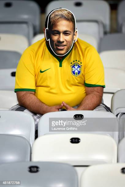 Brazil fan wearing a Neymar mask looks on after a 71 defeat to Germany during the 2014 FIFA World Cup Brazil Semi Final match between Brazil and...