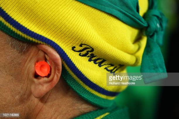 Brazil fan wears ear plugs as he enjoys the atmosphere ahead of the 2010 FIFA World Cup South Africa Group G match between Brazil and North Korea at...