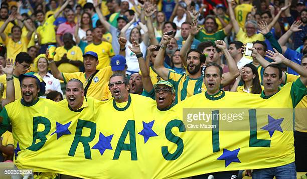 Brazil fans cheer before the Men's Football Final between Brazil and Germany at the Maracana Stadium on Day 15 of the Rio 2016 Olympic Games on...