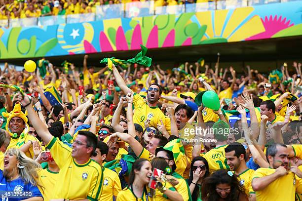 Brazil fans cheer during the 2014 FIFA World Cup Brazil round of 16 match between Brazil and Chile at Estadio Mineirao on June 28 2014 in Belo...
