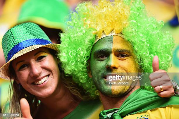 Brazil fans enjoy the atmosphere prior to the 2014 FIFA World Cup Brazil Group A match between Cameroon and Brazil at Estadio Nacional on June 23...