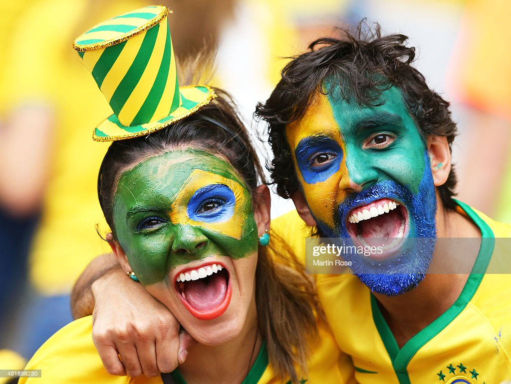Brazil fans enjoy the atmosphere prior to the 2014 FIFA World Cup Brazil Semi Final match between Brazil and Germany at Estadio Mineirao on July 8, 2014 in Belo Horizonte, Brazil.