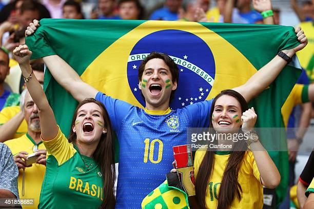 Brazil fans enjoy the atmosphere prior to the 2014 FIFA World Cup Brazil Semi Final match between Brazil and Germany at Estadio Mineirao on July 8...