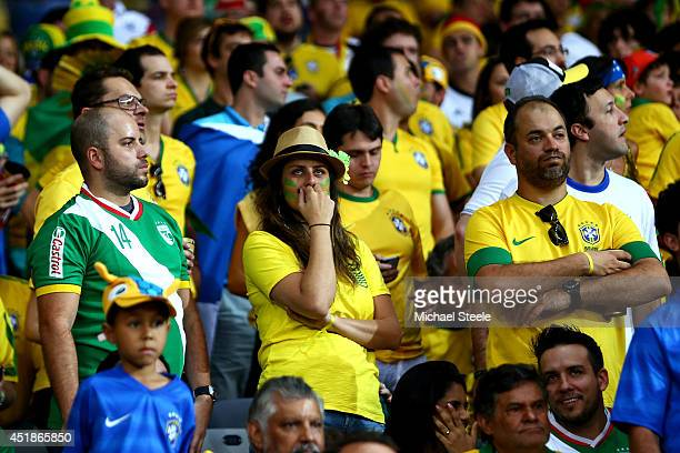 Brazil fans look dejected during the 2014 FIFA World Cup Brazil Semi Final match between Brazil and Germany at Estadio Mineirao on July 8 2014 in...