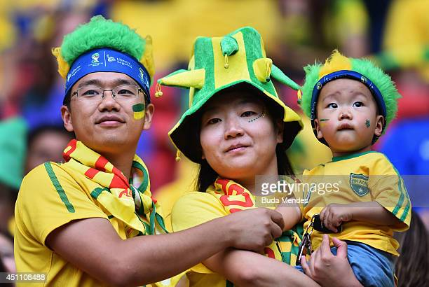 Brazil fans look on prior to the 2014 FIFA World Cup Brazil Group A match between Cameroon and Brazil at Estadio Nacional on June 23 2014 in Brasilia...