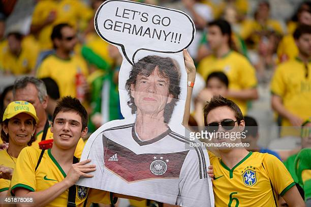 Brazil fans pose with a Mick Jagger poster prior to the 2014 FIFA World Cup Brazil Semi Final match between Brazil and Germany at Estadio Mineirao on...