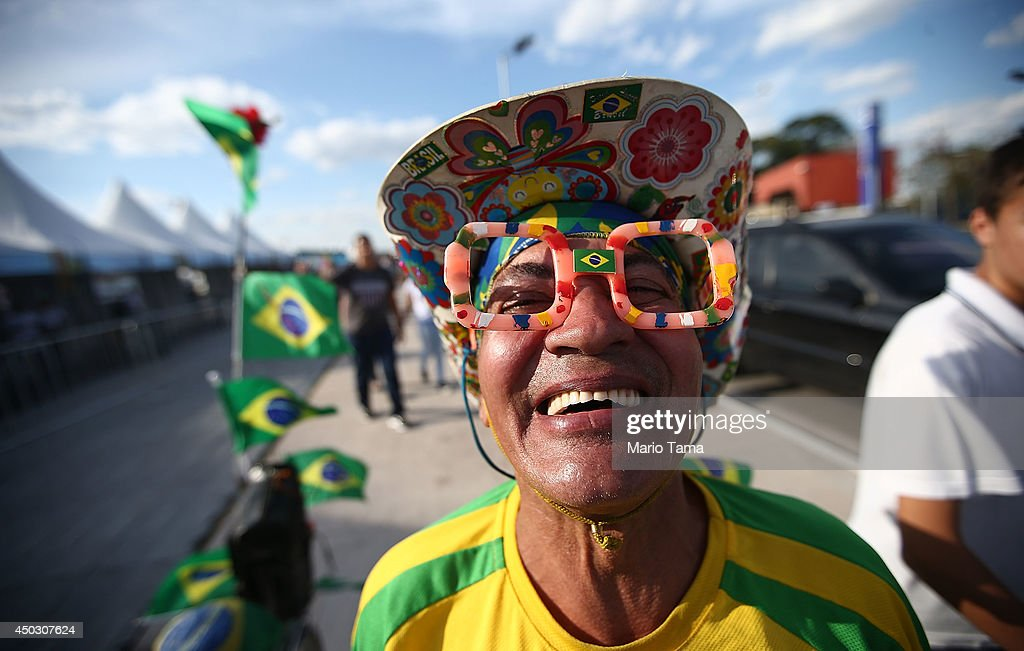 A Brazil fans poses outside of opening ceremony rehearsals around Itaquerao stadium, also known as Arena de Sao Paulo and Arena Corinthians, on June 8, 2014 in Sao Paulo, Brazil. Hundreds of fans turned up at the stadium to take a peek on the final Sunday before the opening of the 2014 FIFA World Cup match on June 12 between Brazil and Croatia. Brazil has won five World Cups, more than any other nation.