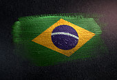 Brazil Flag Made of Metallic Brush Paint on Grunge Dark Wall