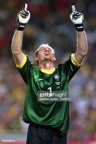Brazil goalkeeper Taffarel celebrates saving the penalty from Philip Cocu of Holland that helped Brazil reach the final of the France 98 World Cup