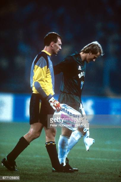 Brazil goalkeeper Taffarel consoles Scotland goalkeeper Jim Leighton after the final whistle Brazil won the match 10