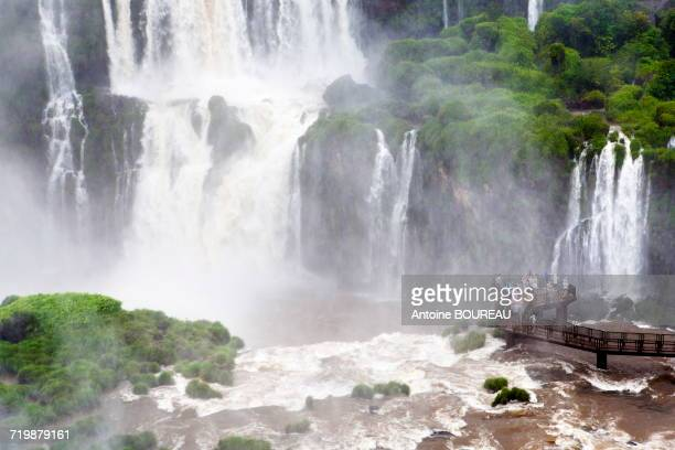 Brazil, Group of tourists on a footbridge under the falls of Iguazu seen from the Brazilian side