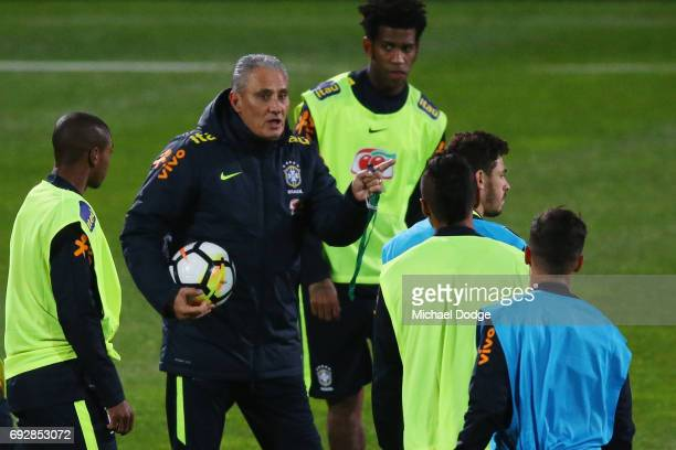 Brazil head coach Tite speaks to his players during a Brazil training session at Lakeside Stadium on June 6 2017 in Melbourne Australia