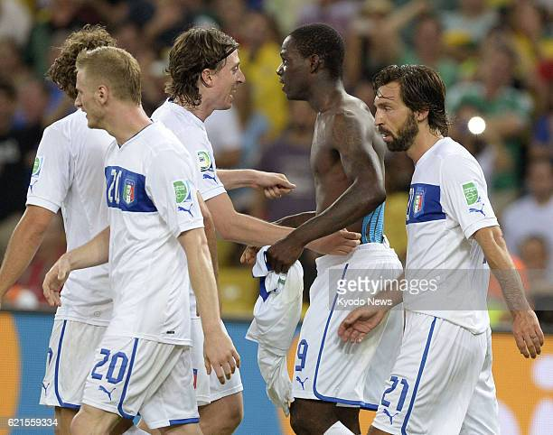JANEIRO Brazil Italy players congratulate forward Mario Balotelli after he scored in the 78th minute of soccer's Confederations Cup Group A game...
