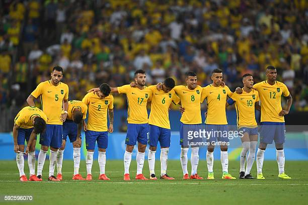 Brazil line up to take their penalties in the penalty shoot out during the Men's Football Final between Brazil and Germany at the Maracana Stadium on...
