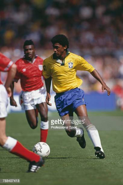 Brazil midfielder Valdo Filho makes a run with the ball as England forward Tony Daley advances from behind in the international friendly match...
