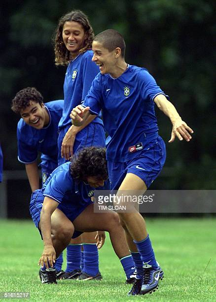 Brazil National Soccer star player Sissi plays a warmup game of tag with her teammates during practice at George Mason University 30 June 1999...