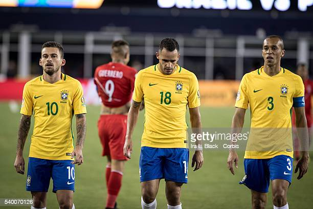 Brazil national team players Lucas Lima Renato Augusto and captain Miranda look beaten with Peru captain Jose Gerrero in the background during the...