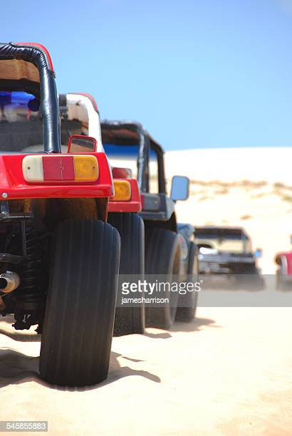 Brazil, Northeast Region, Ceara, Jijoca de Jericoacoara, Beach buggies parked in row on sand