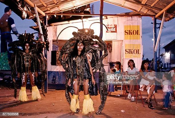 Brazil Parintins The Boi Bumba carnival and a a woman and her giant scorpion costum sit ina oudoor bar resting before entering the stadium known as...