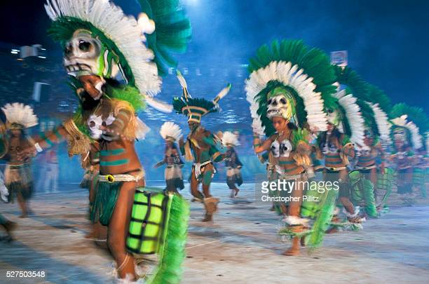 Brazil Parintins The Boi Bumba carnival and a group of Indian warriors dance to infectious rhythms to celebrate the three day event deep in the...