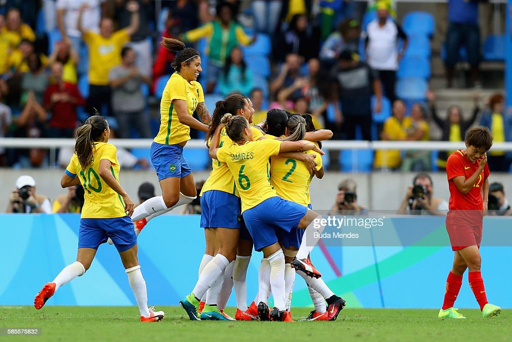 Brazil players celebrate as Monica scores their first goal during the Women's Group E first round match between Brazil and China PR during the Rio...