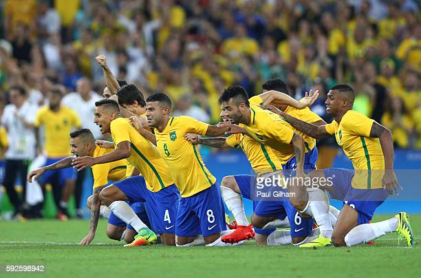 Brazil players celebrate as Neymar of Brazil scores the winning penalty in the penalty shoot out during the Men's Football Final between Brazil and...