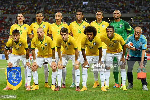 Brazil players line up for the team photos prior to the international friendly match between Japan and Brazil at the National Stadium on October 14...