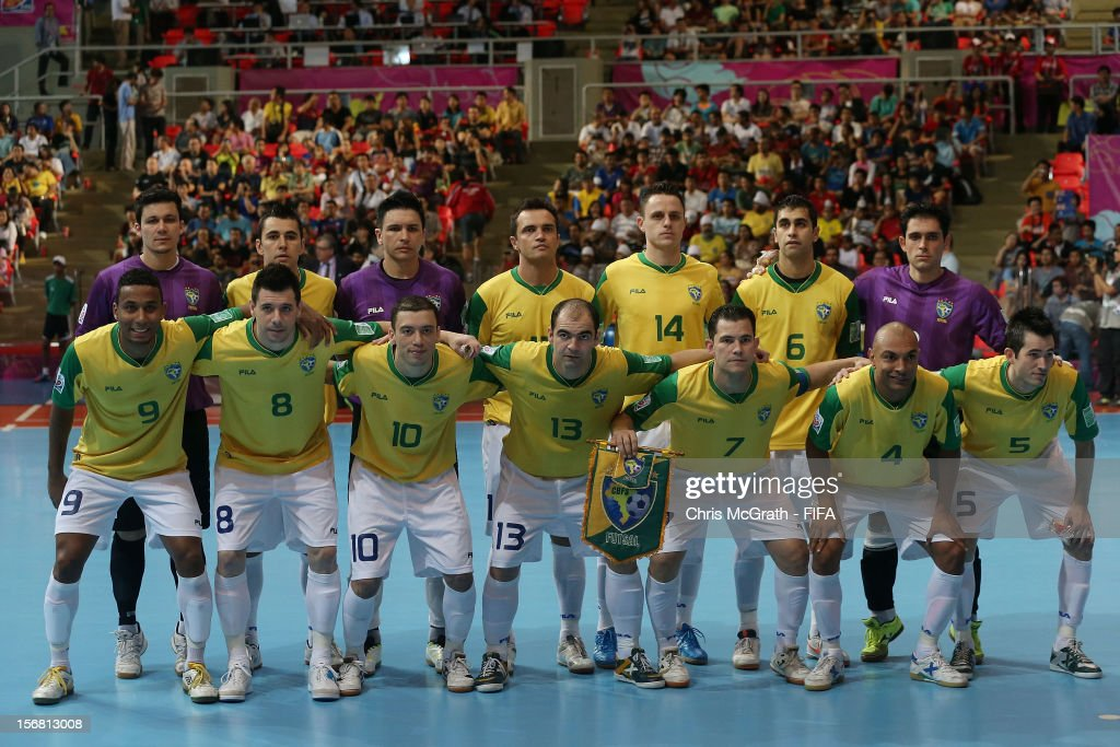 Brazil players pose for a team photo during the FIFA Futsal World Cup Final between Spain and Brazil at Indoor Stadium Huamark on November 18, 2012 in Bangkok, Thailand.