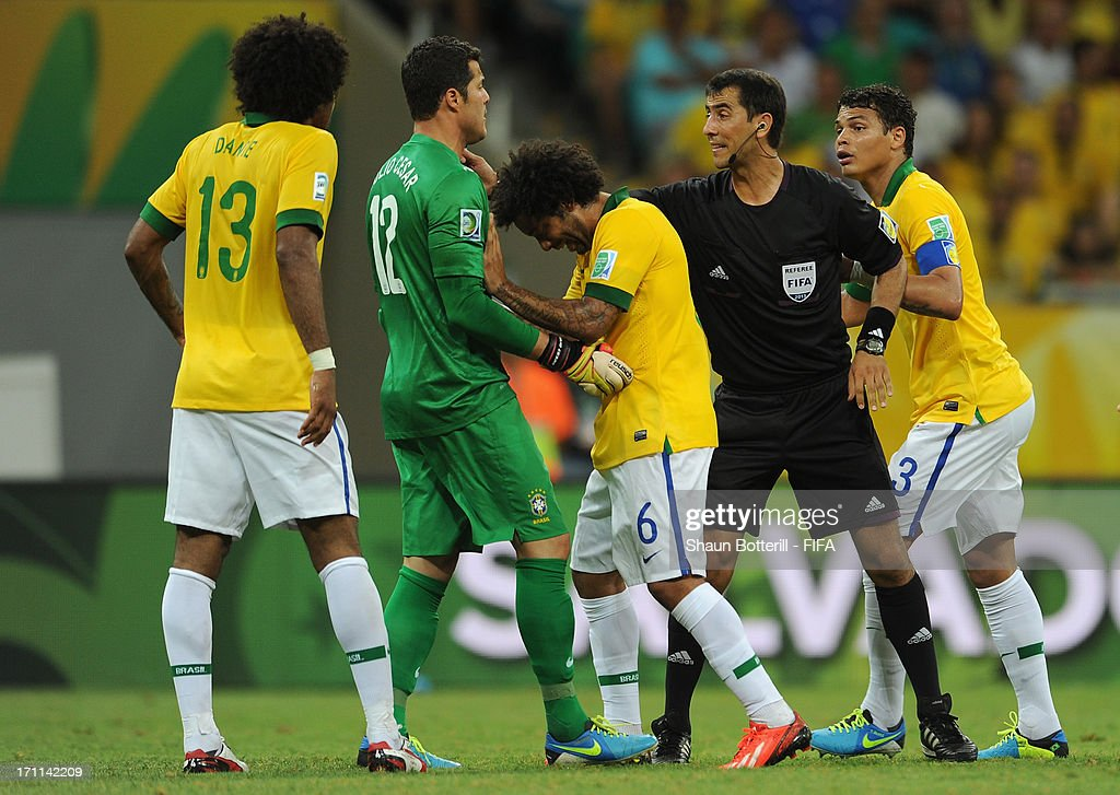 Brazil players protest to referee Ravshan Irmatov as Giorgio Chiellini of Italy (not pictured) scores their second goal during the FIFA Confederations Cup Brazil 2013 Group A match between Italy and Brazil at Estadio Octavio Mangabeira (Arena Fonte Nova Salvador) on June 22, 2013 in Salvador, Brazil.