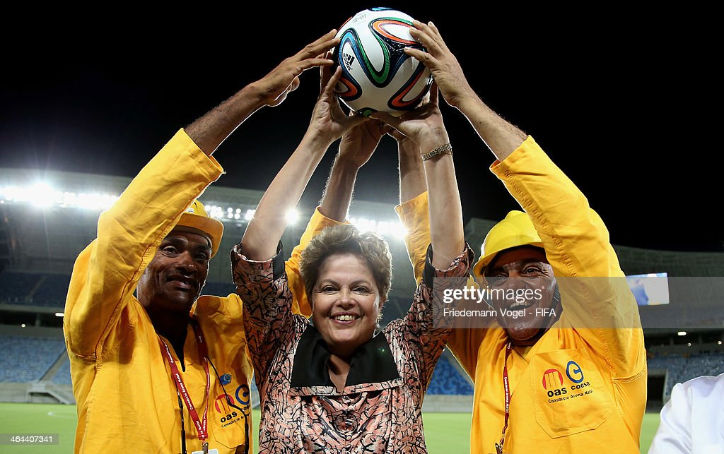 Brazil President Dilma Rousseff poses with construction workers during the opening of the brand new Dunas Arena during the 2014 FIFA World Cup Host City Tour on January 22, 2014 in Natal, Brazil.
