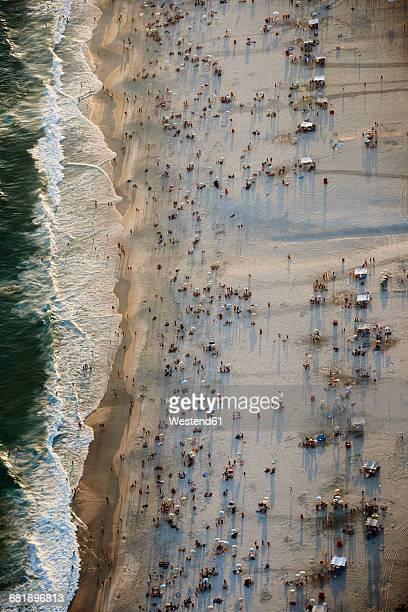 Brazil, Rio de Janeiro, Aerial photograph of Ipanema Beach with weekend crowds