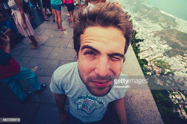 Brazil, Rio de Janeiro, Corcovado, Man twinkling his eye