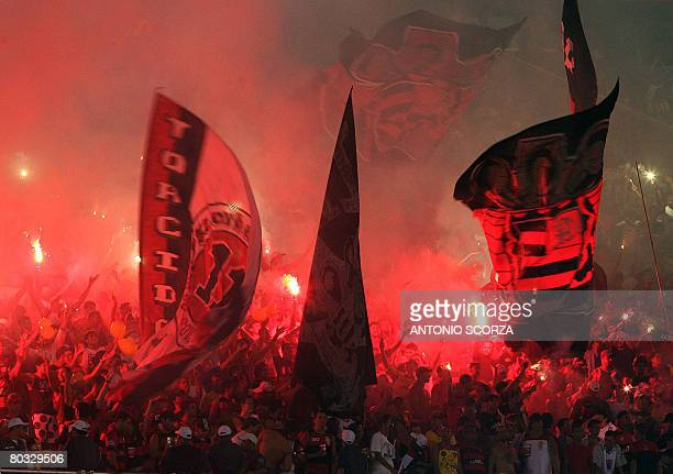 Brazil' s Flamengo soccer fans wave flags paying homage to former team players on March 19 before a Libertadores Cup match against Uruguay's Nacional...