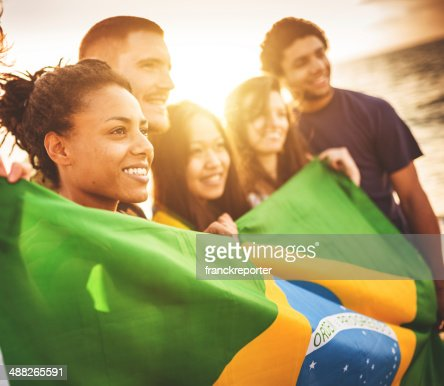 brazil supporter cheering togetherness at the beach soccer match