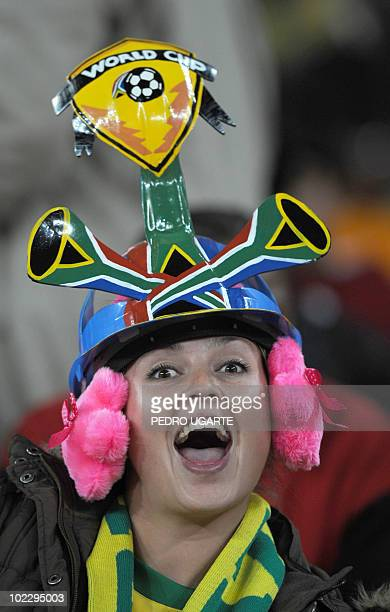A Brazil supporter wearing a Makarapa cheers prior to the start of the Group G first round 2010 World Cup football match Brazil vs Ivory Coast on...