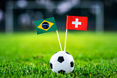 Brazil - Switzerland, Group E, Sunday, 17. June, Football, World Cup, Russia 2018, National Flags on green grass, white football ball on ground.