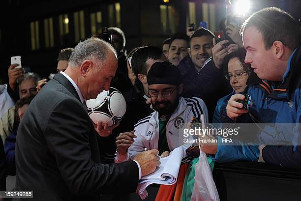 Brazil team coach Luiz Felipe Scolari signs autographs on the red carpet during the FIFA Ballon d'Or Gala 2012 at the Kongresshaus on January 7 2013...