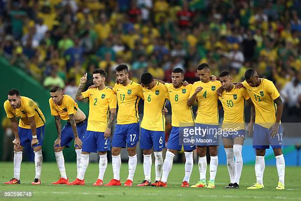 Brazil team huddle during the penalty shoot out during the Men's Football Final between Brazil and Germany at the Maracana Stadium on Day 15 of the...