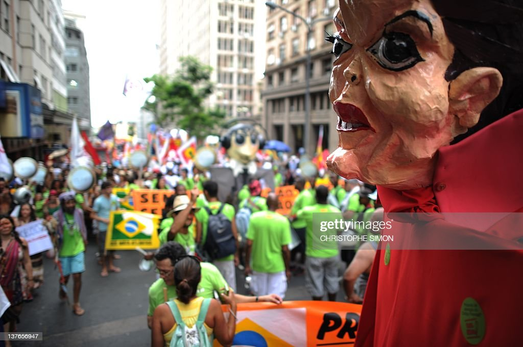 A Brazilan president Dilma Roussef mock head is seen during a demonstration in the Porto Alegre streets for the first day of the 2012 World Social...