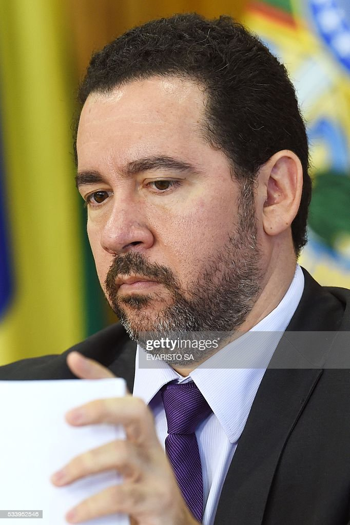 Brazilian acting Planning Minister Dyogo Oliveira during a press conference to explain the government's economic measures aimed at curbing public spending and reviving growth, in the Planalto Palace, the seat of government, in Brasilia on May 24, 2016. / AFP / EVARISTO SA