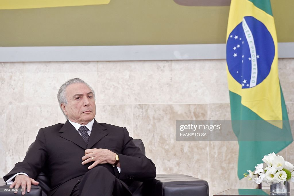 Brazilian acting President Michel Temer attends a ceremony of the presentation of credentials of Ambassadors at Planalto Palace in Brasilia on May 25, 2016. / AFP / EVARISTO SA