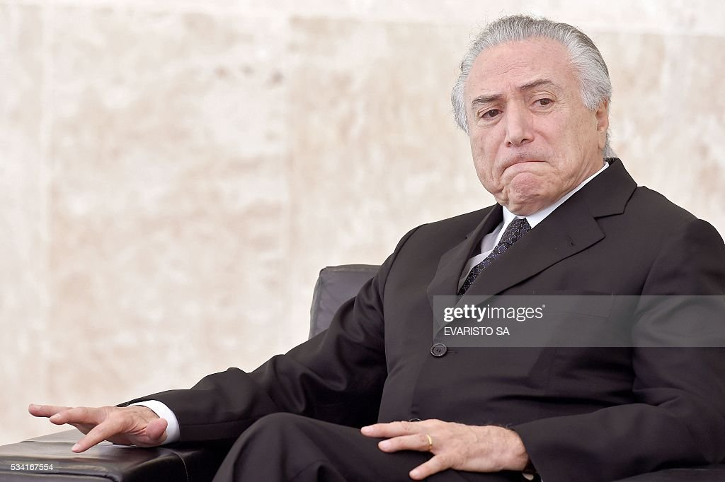Brazilian acting President Michel Temer gestures during a ceremony of the presentation of credentials of Ambassadors at Planalto Palace in Brasilia on May 25, 2016. / AFP / EVARISTO SA