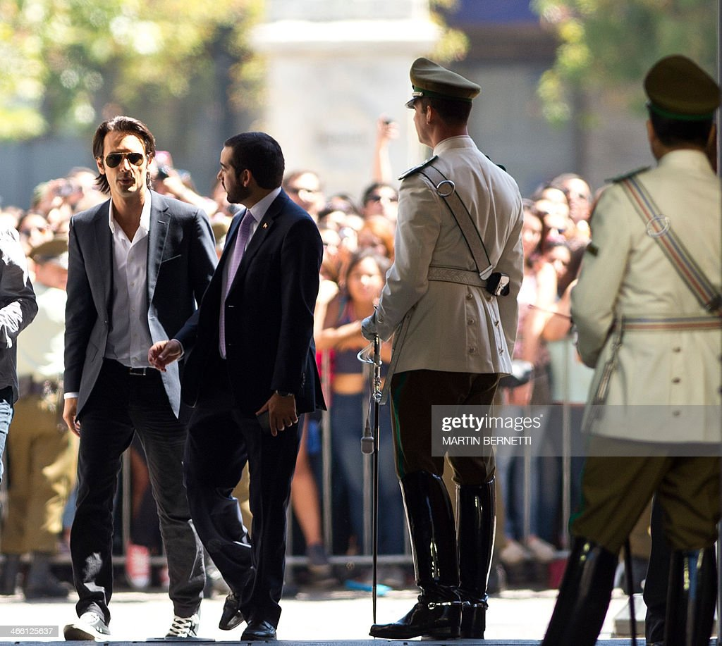 Brazilian actor Rodrigo Santoro arrives at La Moneda presidential palace in Santiago on January 31 where the actors and crew of 'Los 33' film which...