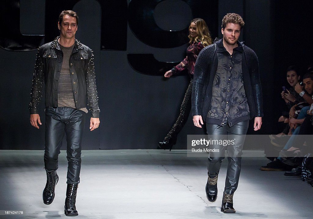 Brazilian actors <a gi-track='captionPersonalityLinkClicked' href=/galleries/search?phrase=Marcello+Antony&family=editorial&specificpeople=2332584 ng-click='$event.stopPropagation()'>Marcello Antony</a> and Thiago Fragoso wear a creation from the TNG at Fashion Rio Winter 2014 at Pier Maua on November 8, 2013 in Rio de Janeiro, Brazil. Photo by Buda Mendes/Getty Images)