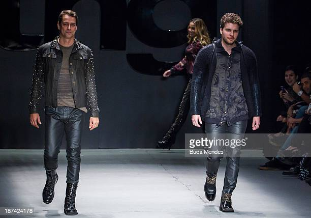 Brazilian actors Marcello Antony and Thiago Fragoso wear a creation from the TNG at Fashion Rio Winter 2014 at Pier Maua on November 8 2013 in Rio de...