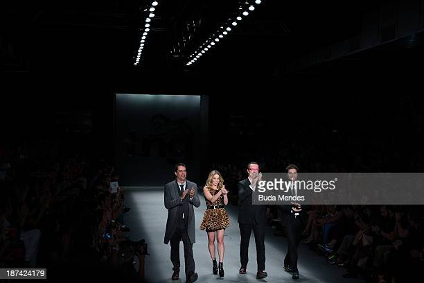 Brazilian actors Marcello Antony Danielle Winits and Thiago Fragoso with Tito Bessa owner of TNG at Fashion Rio Winter 2014 at Pier Maua on November...