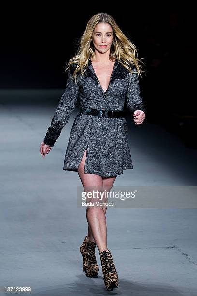 Brazilian actress Danielle Winits wears a creation from the TNG at Fashion Rio Winter 2014 at Pier Maua on November 8 2013 in Rio de Janeiro Brazil...