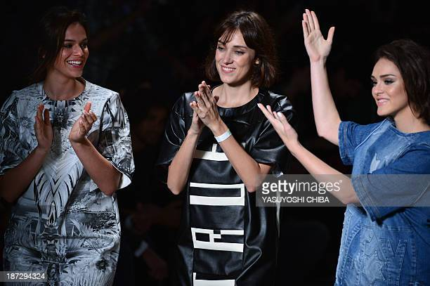 Brazilian actress Isabelle Drummond and Bruna Marquezine the girl friend of Brazilian football player Neymar walks with the designer of CocaCola...