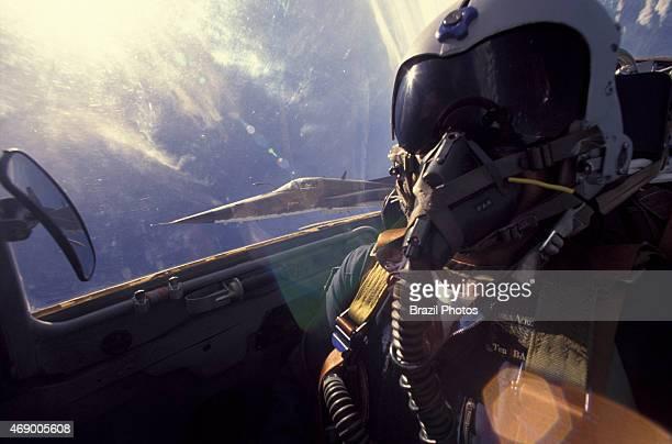Brazilian Air Force pilot flying wearing breathing apparatus